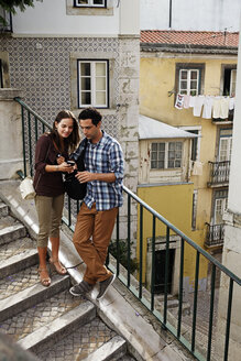 Portugal, Lisboa, Mouraria, young couple standing at stairs - BIF000006