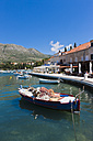 Croatia, Cavtat, Boats in harbour bay near old town - AM001323