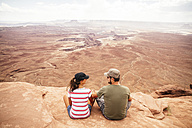 USA, Utah, Young couple looking over Canyonlands National Park - MBEF000888