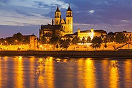 Germany, Saxony-Anhalt, Magdeburg, Cityscape with River Elbe and cathedral at dusk - WDF002083
