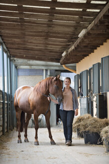 Germany, NRW, Korchenbroich, Young woman with her horse - CLPF000015
