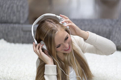 Portrait of smiling young woman with headphones - DRF000295
