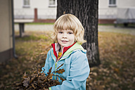 Portrait of little boy holding autumn leaves - MJF000416