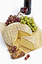 Tomme de Savoie cheese on wooden table - CSF020348