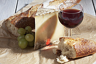 French Bethmale cheese, grapes, baguette and red wine glass - CS020372