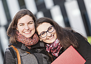 Two happy students outdoors, portrait - DISF000230