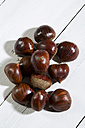 Spanish chestnuts (Castanea sativa) on white wooden table - MAEF007471