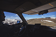 USA, Colorado, Rocky Mountain National Park, Man in recreational vehicle on Trail ridge road - MBE000924