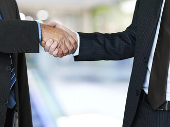 Two businessmen shaking hands - STKF000698