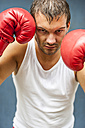 Boxer with red boxing gloves fighting - PAF000084
