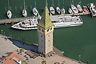 Germany, Bavaria, Lindau, Tourist boat in harbour - SH001117
