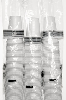 Three stacks of plastic cups wrapped in foil - VI000143