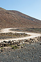 Spain, Fuerteventura, road in between volcanic landscape - VI000186