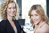 Germany, Neuss, Business people chatting in office - STKF000821