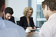 Germany, Neuss, Business people in meeting - STKF000871