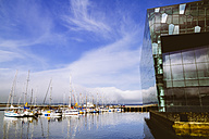 Iceland, Reykjavik, part of facade of Harpa concert hall and harbour - MBE000938
