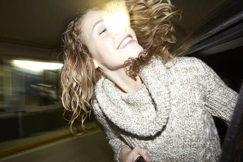 Portrait of happy young woman on the move - FMKF000935