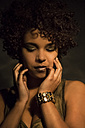 Portrait of female Afro-American with golden make up and bracelet - NGF000073