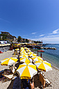 Italy, Liguria, Rapallo, Tourists on beach - AM001438