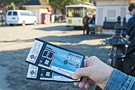 USA, California, San Francisco, Woman holding two tickets for the San Francisco Cable Car - ABA001087