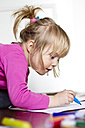 Little girl painting with blue felt tip pen - JFEF000250
