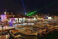 Turkey, Mugla Province, Marmaris, Harbor and old town at night - SIE004837