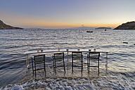 Turkey, Bodrum, Guemuesluek, Bar table on beach - SIE004860