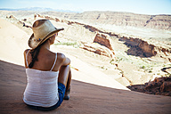USA, Utah, young woman enjoying the view in Arches National Park, back view - MBEF001031