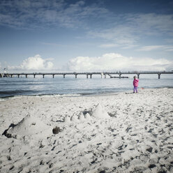 Germany, Mecklenburg-Western Pomerania, Usedom, little child standing at water's edge - WA000041