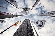 Germany, Hesse, Frankfurt, view to exhibition tower, banners and German flag from below - WA000037