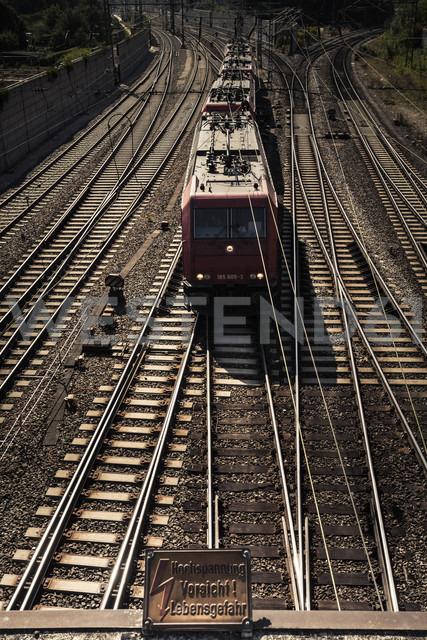 Germany, Baden-Wuerttemberg, Ulm, Locomotives on tracks and warning sign - HA000237