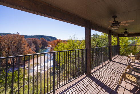 USA, Texas, back porch of guest house with view to Frio river - ABAF001107