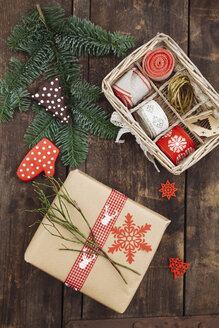 Christmas gift and wrapping material on wooden table - ECF000421