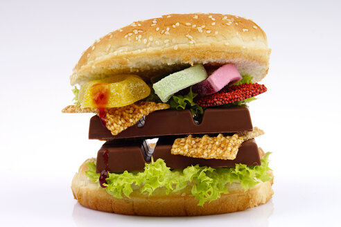 Veggie burger garnished with chocolate and candies - HOHF000286