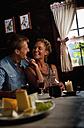 Austria, Salzburg State, Altenmarkt-Zauchensee, couple having an alpine picnic at alpine cabin - HHF004725