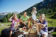Austria, Salzburg State, Altenmarkt-Zauchensee, family with to children having a picnic - HHF004727