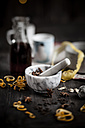 Marble mortar and spices for mulled wine on wooden table - SBDF000386