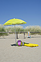 Italy, Sunshade and beach equipment at beach dunes at Adriatic sea - ASF005255