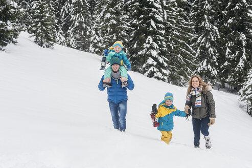 Austria, Salzburg Country, Altenmarkt-Zauchensee, Family walking in snow - HHF004669
