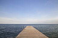 Germany, Schleswig-Holstein, Fehmarn, bathing jetty in front of horizon - WIF000235