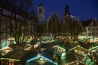Germany, Baden-Wuerttemberg, Freiburg, lightened Christmas market at town hall square at twilight - DHL000201