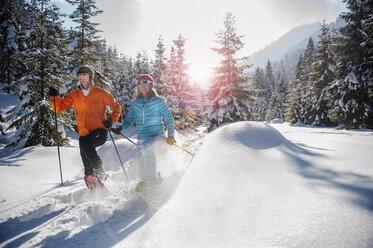 Austria, Salzburg State, Altenmarkt-Zauchensee, Couple snowshoeing in winter landscape - HHF004687
