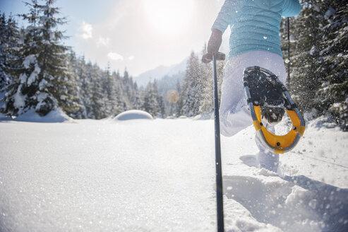 Austria, Salzburg State, Altenmarkt-Zauchensee, Woman snowshoeing in winter landscape - HHF004683