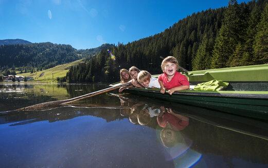 Austria, Salzburg State, Altenmarkt-Zauchensee, woman and children in a boat - HHF004686