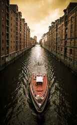 Germany, Hamburg, Hafencity, Speicherstadt, old buildiings and boat - KRP000061