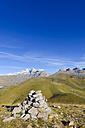 Spain, Aragon, Central Pyrenees, Canon de Anisclo, Ordesa y Monte Perdida National Park, cairn and Las Tres Marias in the background - LAF000371