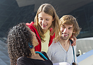Germany, Bavaria, Munich, Three smiling friends outdoors - HSI000300