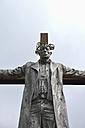 Germany, Bavaria, Baldham, aluminium sculpture by heike rose schmidt-pfeil, man hanging on a crisscross - AX000611