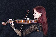Young woman dressed in Gothic style playing violin - DR000351