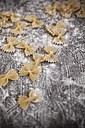 Farfalle on wooden table with flour - SBDF000395